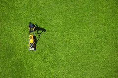 Lawn. A man mowing the lawn Royalty Free Stock Photo