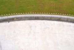 Lawn with modern. Steel piping for safety and white stone floor royalty free stock images