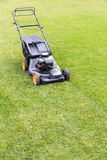Lawn mover on green lawn Royalty Free Stock Images