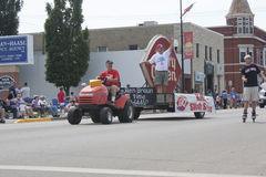 Lawn Mover pulling Dairy Queen Float Stock Image