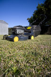 Lawn Mower. Sitting In A Grassy Backyard Royalty Free Stock Photos