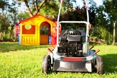 Lawn Mower. In Garden Stock Photography