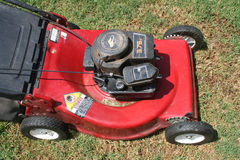 Lawn Mower. Looking down at a red lawn mower Royalty Free Stock Photography