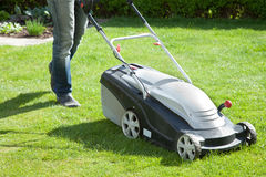 Lawn mower. Outdoor shot of a man mowing the lawn Stock Image
