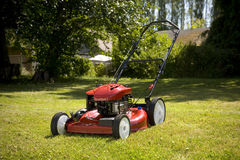 Lawn Mower. A red lawn mower in fresh cut grass Royalty Free Stock Photos