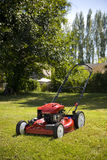 Lawn Mower. A red lawn mower in fresh cut grass Royalty Free Stock Image