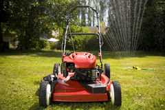 Lawn Mower. A red lawn mower in fresh cut grass Royalty Free Stock Photo