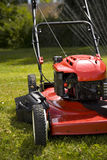 Lawn Mower. A red lawn mower in fresh cut grass Royalty Free Stock Photography
