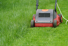Lawn mower. On green grass Royalty Free Stock Photo