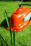 Lawn mower. Electric lawn mower behind some grass Royalty Free Stock Images