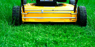 Lawn mower. Forwarding through the grass Stock Images