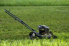 Lawn Mower in Backyard. With Green Grass Stock Photography