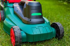 Lawn mower in the backyard Royalty Free Stock Photography