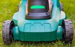 Lawn mower in the backyard Stock Images