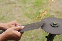 Lawn mower blade sharpening. Royalty Free Stock Image