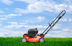 Lawn mower clipping green grass Stock Photo