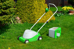 Lawn-mower with the container for a grass Royalty Free Stock Photo