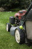 Lawn mower. Cut the grass in garden Stock Photography