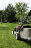 Lawn mower. Cut the grass in garden Royalty Free Stock Image