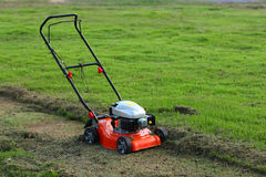 Lawn mower cutting grass Royalty Free Stock Photo