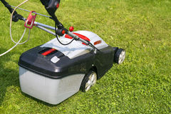 Lawn-mower electric on green grass Stock Photos