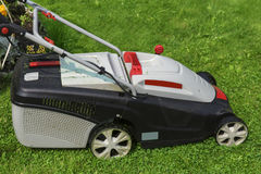 lawn-mower electric on green grass Royalty Free Stock Photo