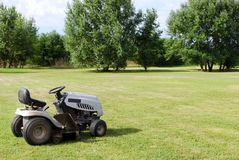 Lawn mower on field Stock Images