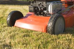 Lawn mower fragment. Lawnmower on the sunlit lawn Stock Photos