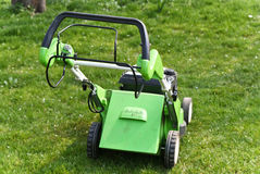 Lawn mower on fresh cut grass. In the garden Royalty Free Stock Image