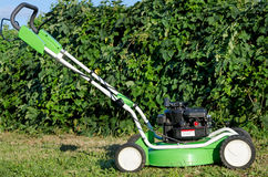 Lawn mower in the garden Royalty Free Stock Photography