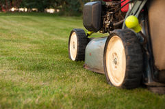 Lawn mower. In a garden Royalty Free Stock Photography