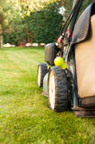 Lawn mower. In a garden Stock Photo
