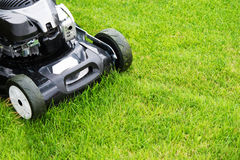 Lawn mower in the garden. Stock Photo
