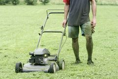 Lawn mower and gardener Stock Image