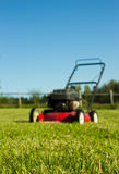 Lawn mower on grass Stock Photos