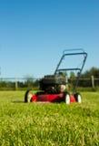 Lawn mower on grass Stock Photos