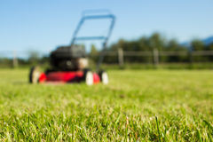 Lawn mower on grass royalty free stock photography