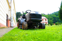 Lawn mower on the grass Stock Photo