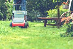 Lawn mower mower grass equipment mowing gardener care work tool.  stock image