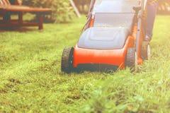 Lawn mower mower grass equipment mowing gardener care work tool.  royalty free stock photo