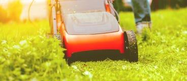 Lawn mower mower grass equipment mowing gardener care work tool.  royalty free stock photos