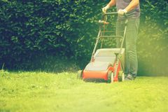 Lawn mower mower grass equipment mowing gardener care work tool.  royalty free stock images