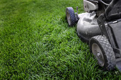 Lawn Mower on Grass Preparing to Mow Royalty Free Stock Images