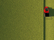 Lawn mower on green field. Top view of lawn mower on green field Stock Image