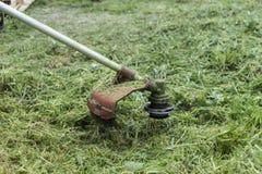 Lawn mower. On green grass Stock Photos