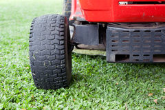 Lawn mower and green grass Stock Images