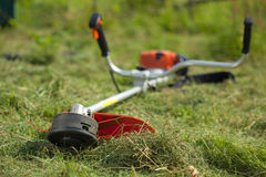 Lawn mower on green grasss Stock Image