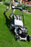 Lawn mower on green lawn Stock Photography