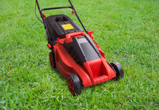 Lawn mower on green lawn Stock Photo