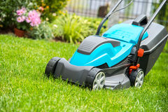 Lawn mower on a green meadow stock photos